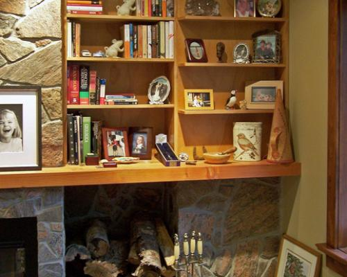A close view of the bookshelves built into the wall around the fireplace.