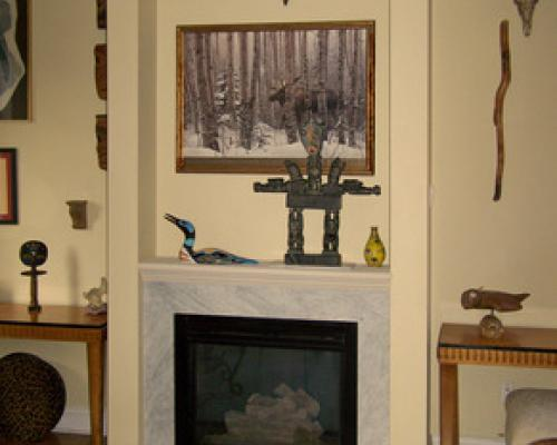 A stone fireplace, with a very simple mantelpiece, before the new one.