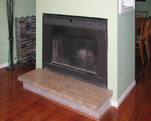 A fireplace without a mantelpiece.