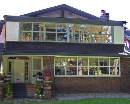 The house, with smaller ground floor windows, and no cedar on either the first or second floor facade.