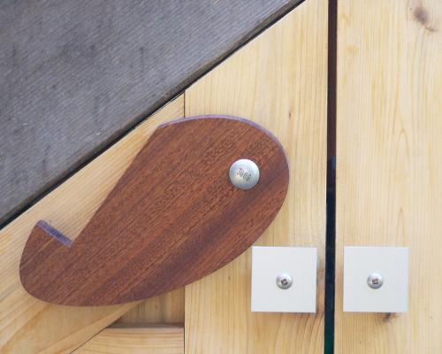 A close up of the latch, open, shaped like a water drop.