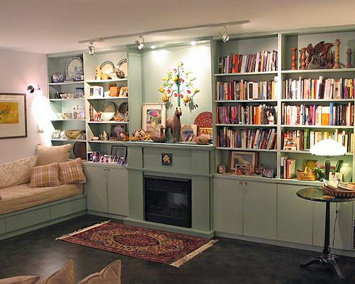 A photo of shelves built around a fireplace.